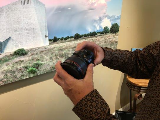 Robert Flaherty holds the tilt shift lens that helps