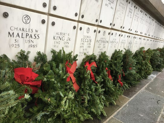 Wreaths wrest against the walls of the Columbarium