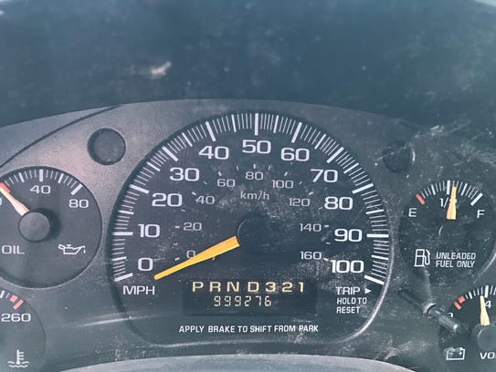 The odometer on a 1999 Chevrolet 2500 cargo van is