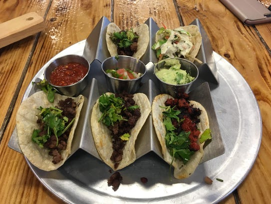 One Stop Kitchen & Bar offers $1 tacos on Taco Tuesday.