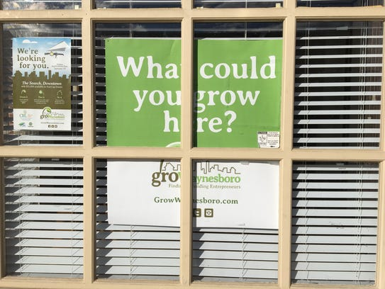 A Grow Waynesboro sign hangs in an empty storefront