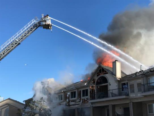 Farmington Hills firefighters helped battle an apartment
