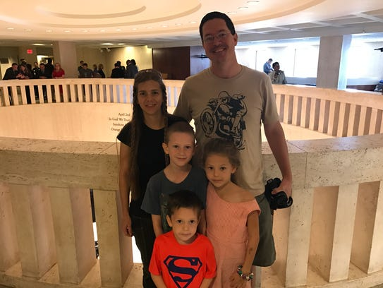 Chris and Sarah Bloomfield with their children at the