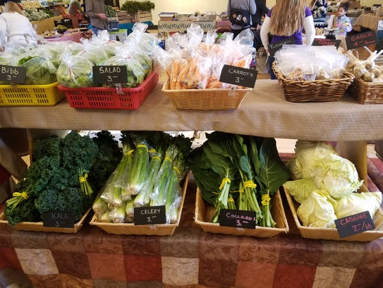 Celery, carrots, greens and more from New Moon Herbs.