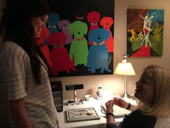 Katie Harrison interacts with her caregiver from Care