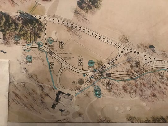This aerial schematic shows in blue how walking trails