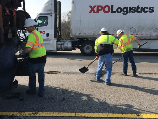 TDOT workers repair potholes on I-40 East near downtown.