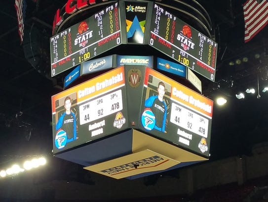 The primary scoreboard at the Kohl Center shows the