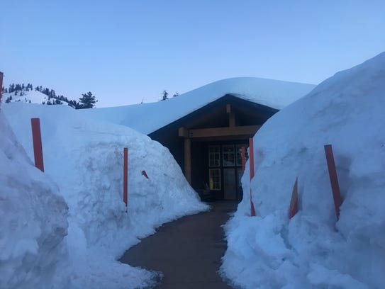 Snow piled to the rooftop of the Kohm Yah-mah-nee Visitor