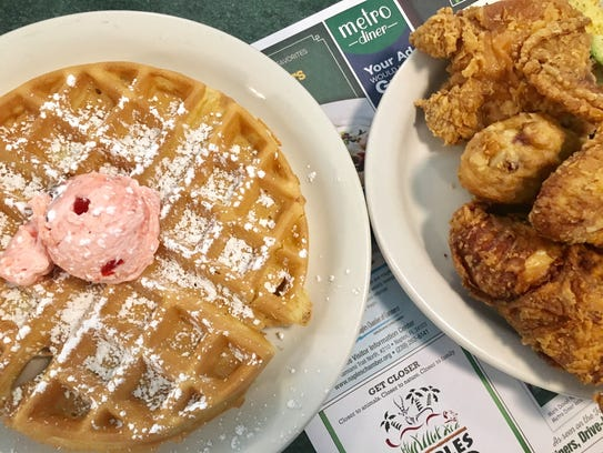 Fried chicken and a waffle with strawberry butter from