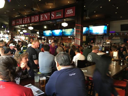 Fans crowd McFadden's Restaurant and Saloon in Glendale