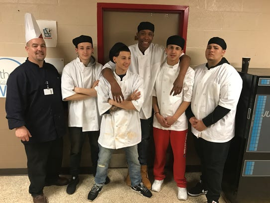 Gathered for a group shot, Chef Trevor Sipe, and Youth
