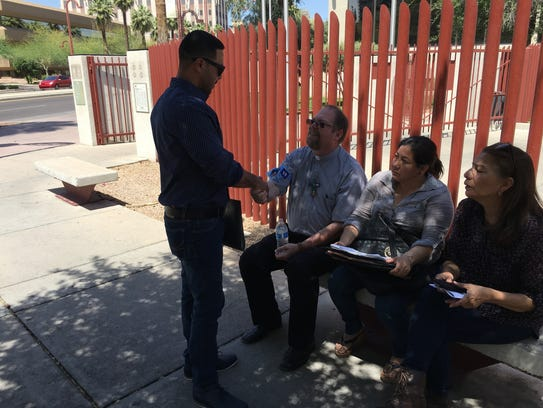 Marco Tulio Coss-Ponce shakes the hand of pastor Ken