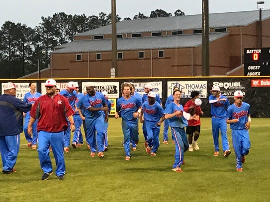 The Pine Forest baseball team celebrates their 5-2