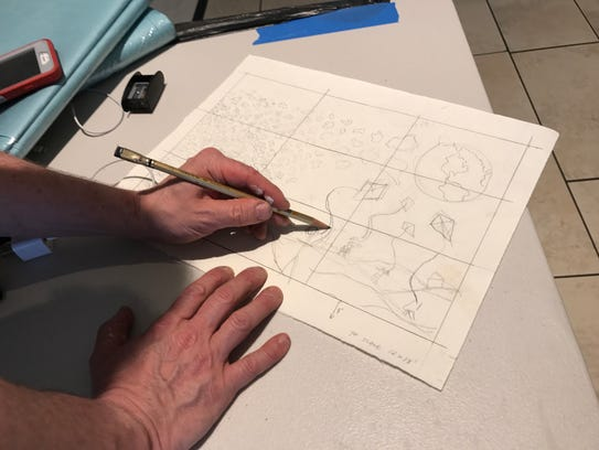 Artist Chuck Webster working on his sketch for the