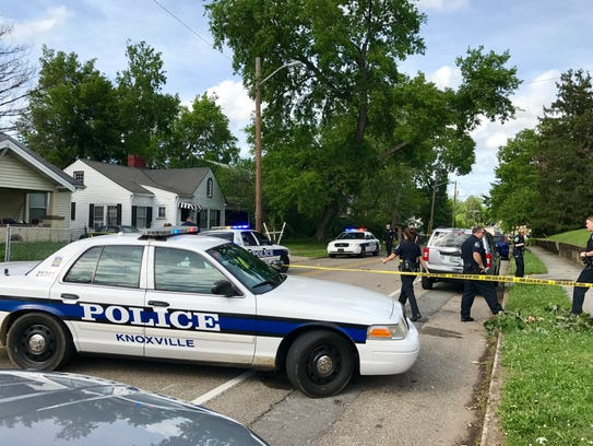 Police respond to a shooting on East Fifth Avenue on