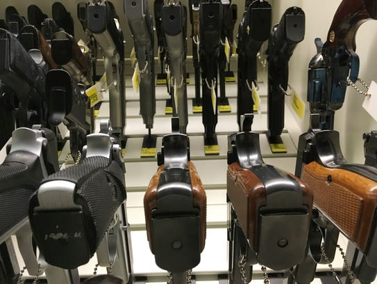 Rows of guns hang from a display case at New Jersey