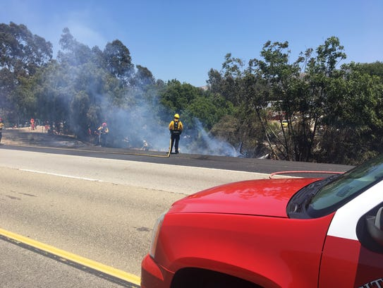 Crews put out a fire along Highway 33 on Friday near