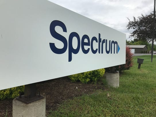The Spectrum sign at the entrance of the company's