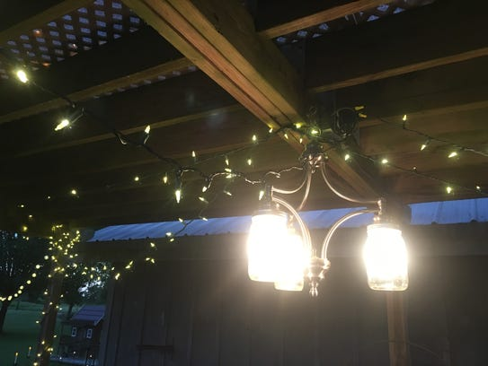 Simple white bulbs strung in the yard can brighten