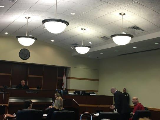 Mark Sievers looks on as his attorney Michael Mummert