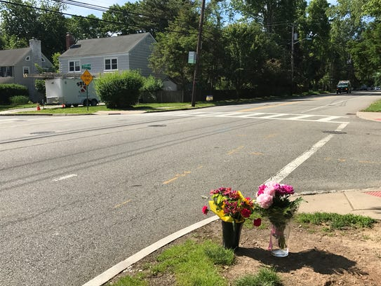 Flowers sit at the corner of Grove Street and Carolin