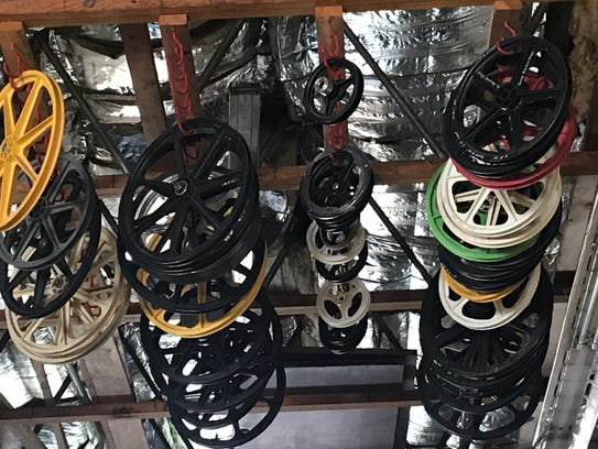TUFF Wheels hang from the rafters inside Skyway's facility