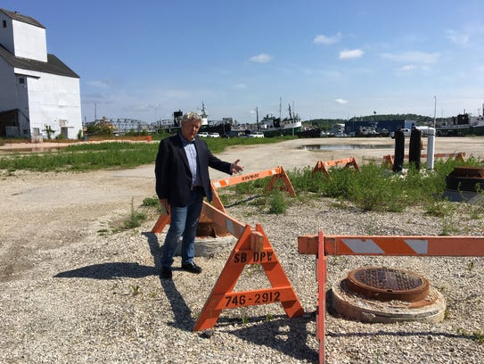 Bob Papke points to the sewer hookup installed by the