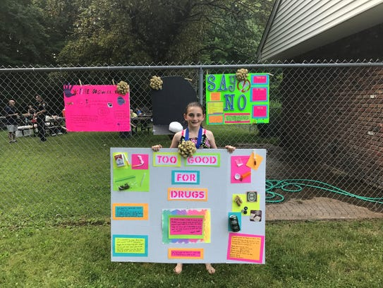 Poster contest winner Allyson Sheldon with her poster