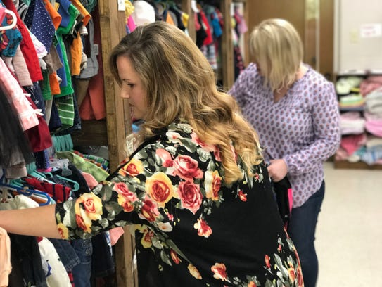 Foster Care Closet organizers Karley Duhon (left) and