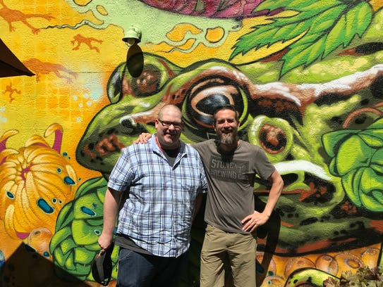 Greg Koch, co-founder of Stone Brewing, right, with