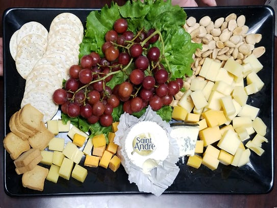 A tray of unique cheeses--Clockwise from lower left: