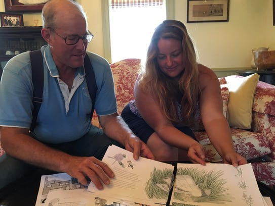 Father and daughter, Joel and Rachel Salatin, sit in