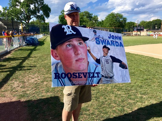 A Roosevelt fan holds up a commemorative sign for John