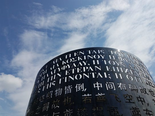 Seven languages represented on two metal cylinders,