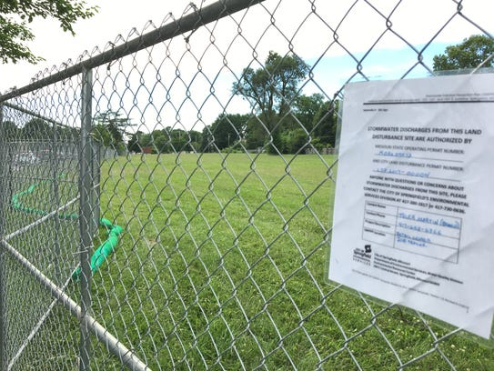 A notice on the fence says the project is going to