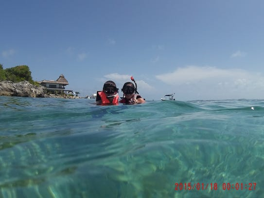 Seth and Carol Ann Warren snorkel the clear waters