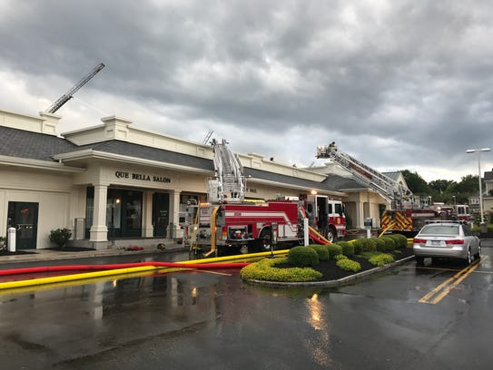 Firefighters on scene at a four-alarm fire at TimeSaver