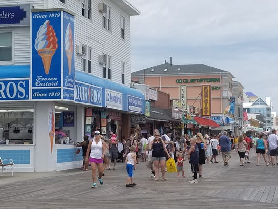 The Boardwalk is busy Sunday in Ocean City with beachgoers