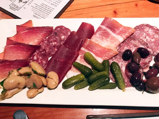 The charcuterie board at Patria is a first-class way
