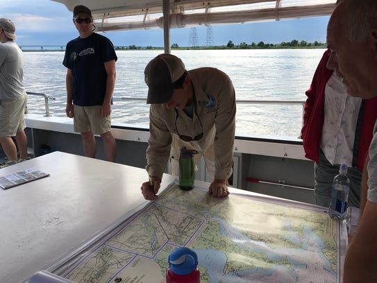 "Adam Wickline (center) examines the route the ""Summer"