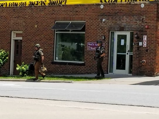 Bomb squad members respond to a reported suspicious