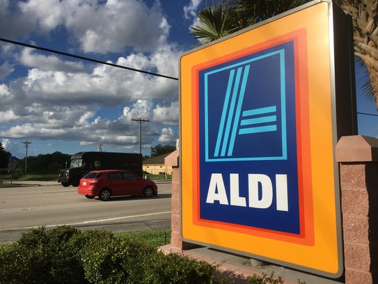Motorists pass the Aldi store on Lee Boulevard in Lehigh Acres.