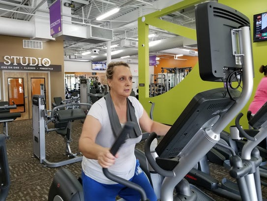 Shelly Wilson, of Clyde, works on her cardio on the