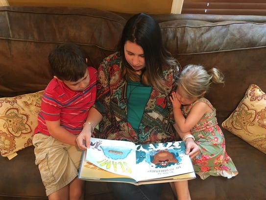 Stephanie Wilkes reads to her two children.