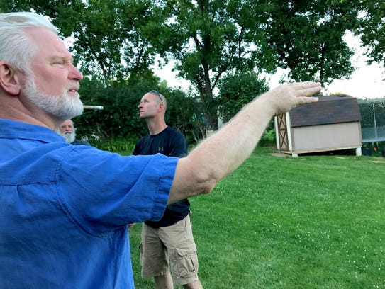 Splitrock Heights resident John Brown points out over