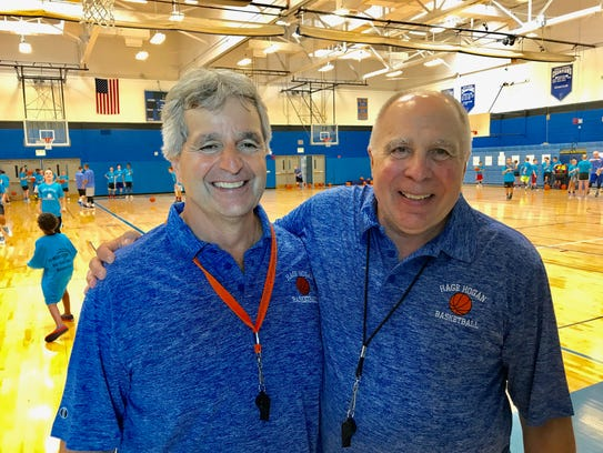 Charlie Hage, left, and Jack Hogan started their coaching