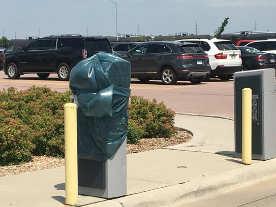 A parking ticket dispenser was damaged at the Sioux