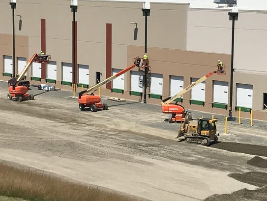 Crews works on roof drains at the 625,000-square-foot