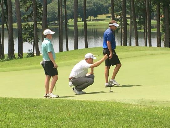 PGA Tour player Patton Kizzire (middle in white shirt